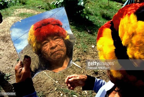 The world of Jivaro Indians in Ecuador in 1994 Reflection of the Achuar Shaman in a broken mirror