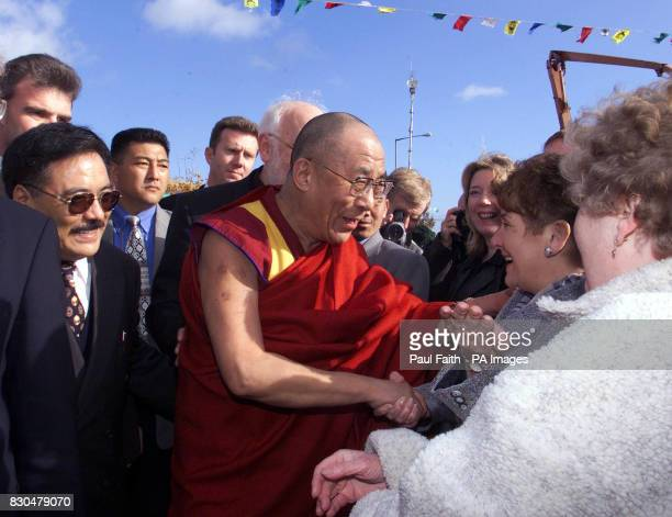 The world renowned Buddhist leader of Tibet the Dalai Lama blesses local residents stood at the peace gates at workman avenue in west Belfast on the...