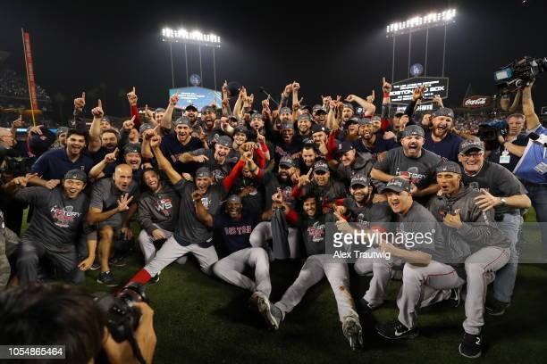 The World Series champion Boston Red Sox pose for a team photo on the field after defeating the Los Angeles Dodgers in Game 5 of the 2018 World...