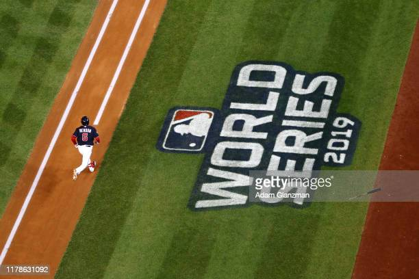 The World Series logo can be seen as Anthony Rendon of the Washington Nationals bats during Game 5 of the 2019 World Series between the Houston...