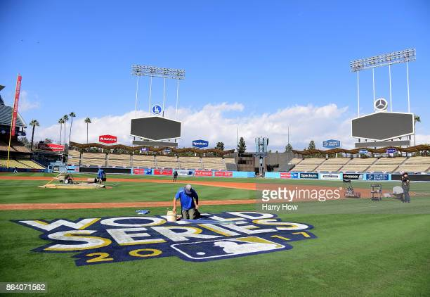 The World Series logo is painted on to the field in preparation for game one and two at Dodger Stadium on October 20 2017 in Los Angeles California