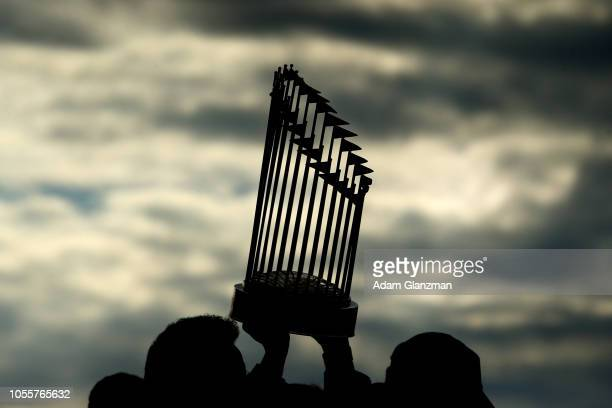 The World Series trophy is hoisted in the air during the 2018 World Series victory parade for the Boston Red Sox on October 31 2018 in Boston...