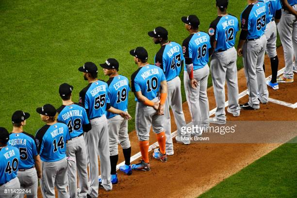 The World Team stands for the National Anthem prior to the SiriusXM AllStar Futures Game against the US Team at Marlins Park on July 9 2017 in Miami...