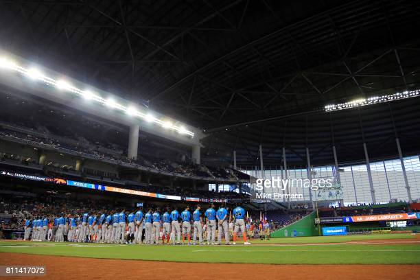 The World Team takes part in pregame ceremonies prior to the SiriusXM AllStar Futures Game against the US Team at Marlins Park on July 9 2017 in...