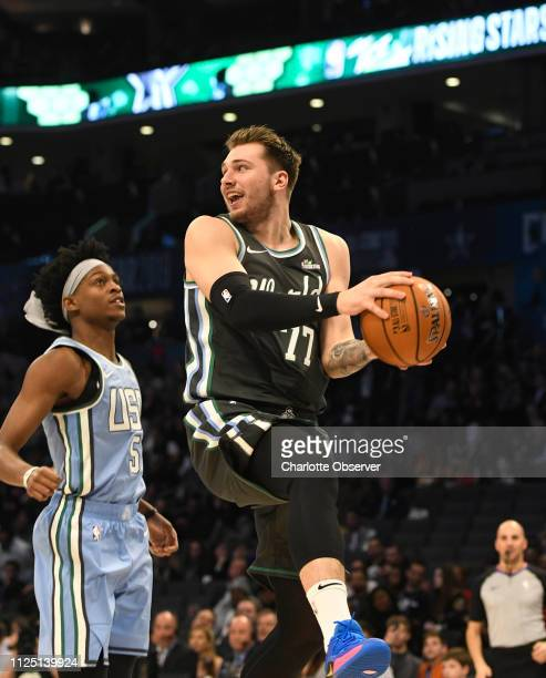 The World Team's Luka Doncic of the Dallas Mavericks drives past the US Team's De'Aaron Fox of the Sacramento Kings during the MTN DEW ICE Rising...
