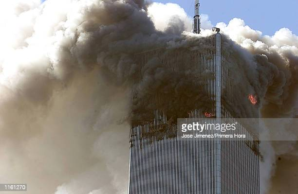 The World Trade Center burns after two planes hit it September 11 2001 in New York City