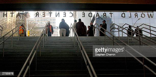 The World Trade Center Path sign is silhouetted as people wait to ride the inaugural PATH train November 23 2003 in New York CityThe Path station at...