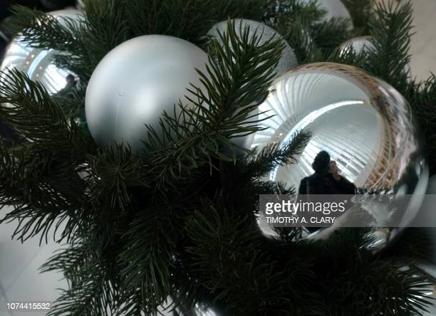 The World Trade Center Transportation Hub's Oculus is reflected in a Christmas Ball Ornament hanging on the railing at the Oculus December 19, 2018...