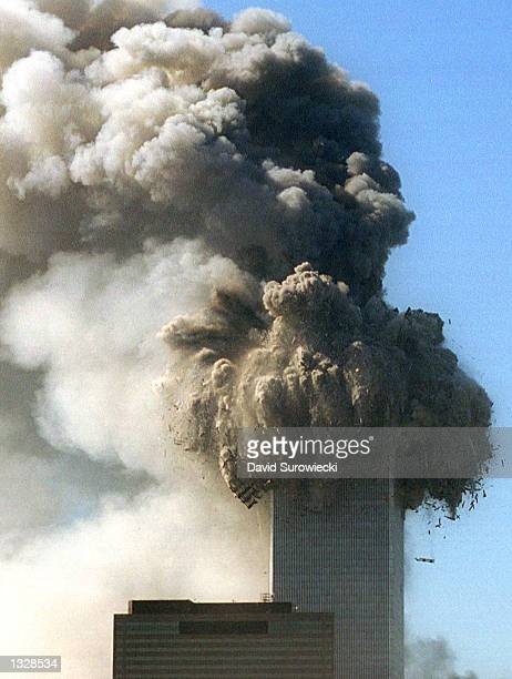 The World Trade Center''s top stories collapse after being hit by two planes during a suspected terrorist attack September 11, 2001 in New York City.