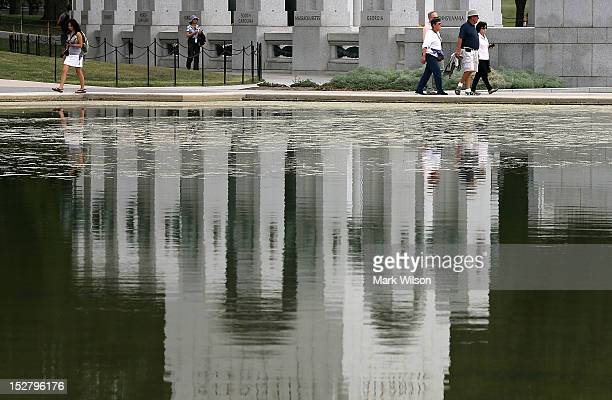 The World War II memorial is reflected onto the Reflecting Pool in front of the Lincoln Memorial that is full of algae after recently being filled...
