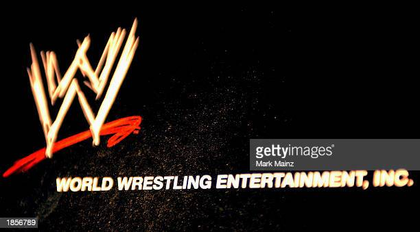 The World Wrestling Entertainment logo hangs on a wall at a media conference announcing the allstar lineup of WWE WrestleMania XIX at ESPN Zone in...