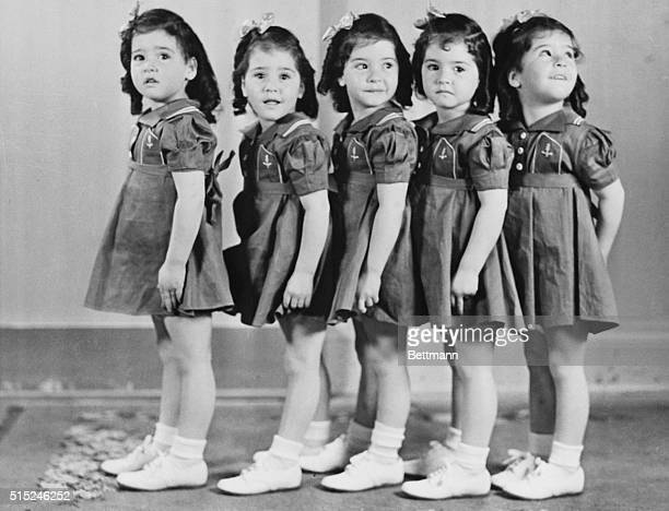 The worldfamed Dionne Quintuplets are presently enjoying their first visit to New York where they are guests of Francis Cardinal Spellman The...