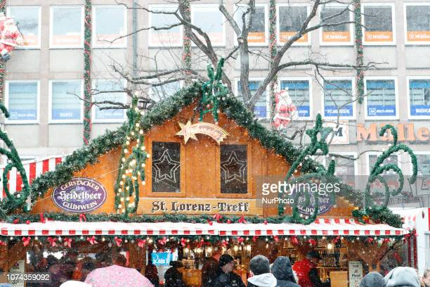 The worldfamous Christmas Market of Nuremberg was full of people even if there was heavy snowfall and cold