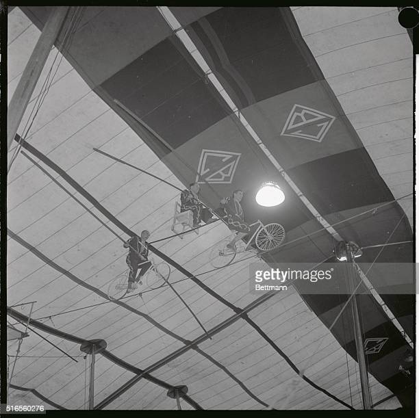 The worldfamous Wallendas perform their highwire act during the opening performance of the circus which started today at Palisades Amusement Park in...