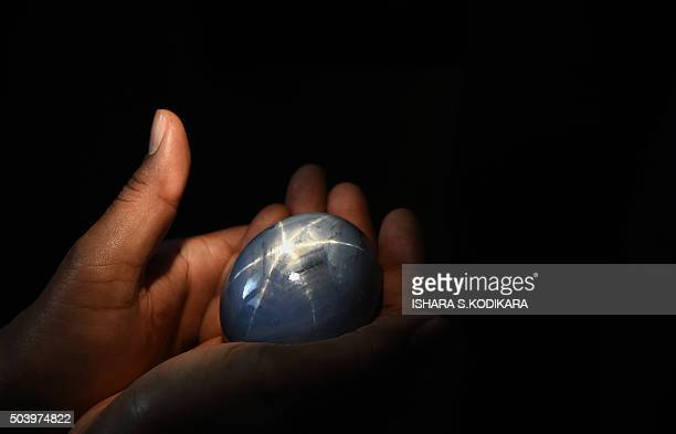 The worlds biggest blue star sapphire the Lankan Star of Adam is shown by its owner in Colombo on January 8 2016 A Sri Lankan gem trader who owns the...
