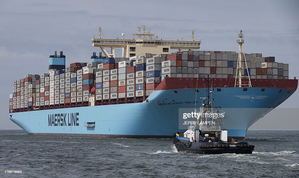 The world's biggest container ship, named the Maersk MC-Kinney Moller, arrives on August 16, 2013 at the port of Rotterdam, in the Netherlands. The ship carries the first Triple-E Standard (Economy of Scale, Energy Efficiency, Environmentally-improved) and is the most efficient and energy saving container ship in the world. The ship has a length of 400 meters and is capable of delivering more goods than ever, while using less fuel consumption and lower CO2 emissions. AFP PHOTO / ANP / JERRY LAMPEN -- netherlands out --