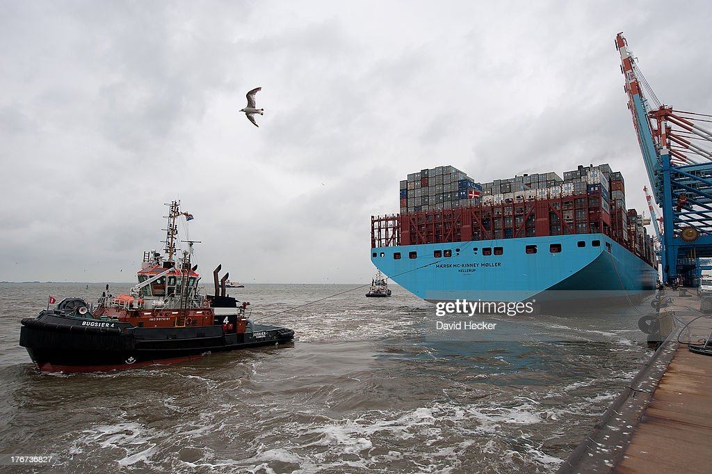 The world's biggest container ship, the Maersk MC-Kinney Moller arrives at the port of Bremerhaven on August 18, 2013 in Bremerhaven, Germany. The world's largest container ship, the Maersk MC-Kinney Moller, arrives at the port of Bremerhaven on Sunday. It has a length of 400 meters, it is 59 meters wide and is capable of delivering 18.000 TEU Container. The ship carries the first Triple-E Standard (Economy of Scale, Energy Efficiency, Environmentally-improved) and is the most efficient and energy saving container ship in the world.