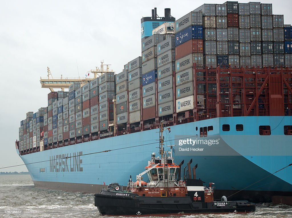 The world's biggest container ship, the Maersk MC-Kinney Moller as it arrives at the port of Bremerhaven on August 18, 2013 in Bremerhaven, Germany. The world's largest container ship, the Maersk MC-Kinney Moller, arrives at the port of Bremerhaven on Sunday. It has a length of 400 meters, it is 59 meters wide and is capable of delivering 18.000 TEU Container. The ship carries the first Triple-E Standard (Economy of Scale, Energy Efficiency, Environmentally-improved) and is the most efficient and energy saving container ship in the world.