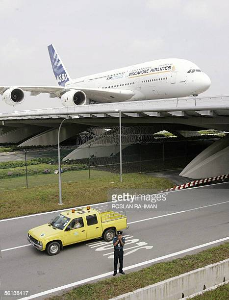 The world's biggest passenger jet an Airbus A380 superjumbo taxis along a bridge at Changi International Airport in Singapore 11 November 2005 The...