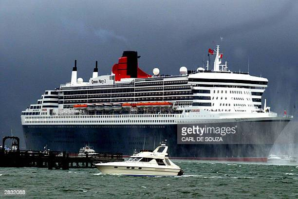 The world's biggest passenger liner the Queen Mary 2 arrives in Southampton 26 December 2003 Several hundred people headed to Southampton Water on a...