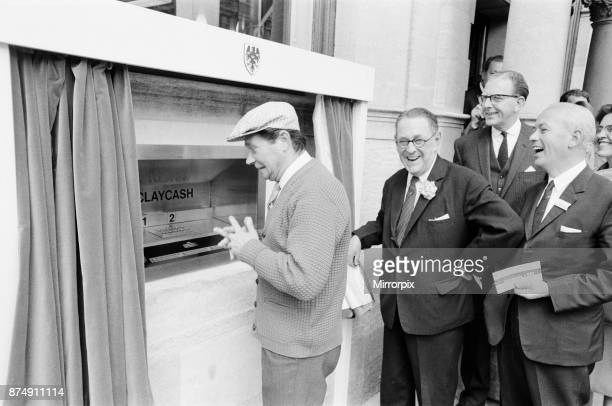 The Worlds First ATM, Cash Machine is unveiled at Barclays Bank, in Enfield, Middlesex, just North of London, 27th June 1967. Picture shows actor Reg...