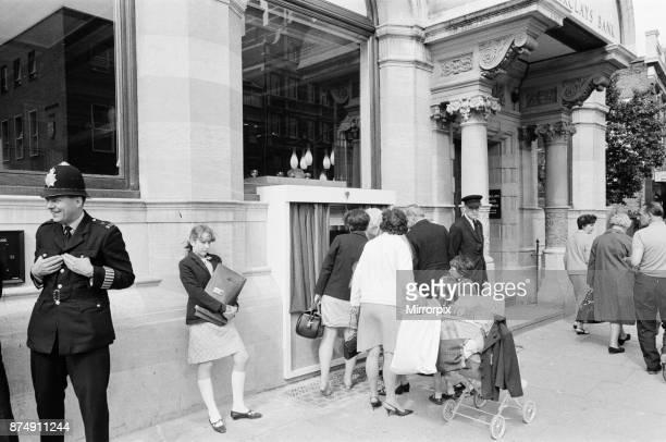 The Worlds First ATM Cash Machine is unveiled at Barclays Bank in Enfield Middlesex just North of London 27th June 1967 Picture shows the crowd of...