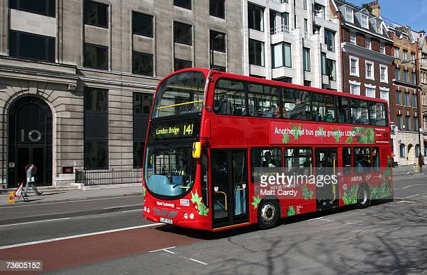 The World's first diesel electric hybrid double decker bus parks in front of London's City Hall before it goes into service on route 141 in London on...