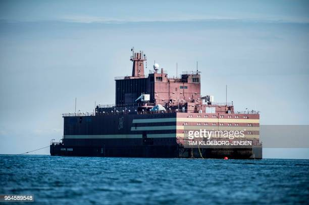 The world's first floating nuclear power plant Russian Academy Lomonosov passes by the island of Langeland off the coast of Spodsbjerg in Denmark on...