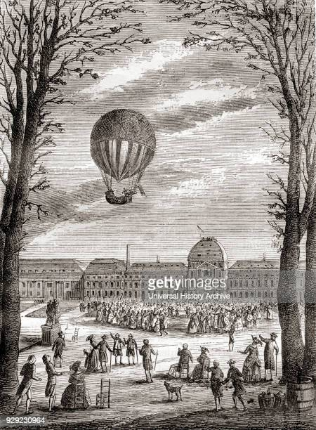 The world's first manned hydrogen balloon flight over the Champs de Mars Paris France in 1 December 1783 piloted by NicolasLouis Robert and professor...
