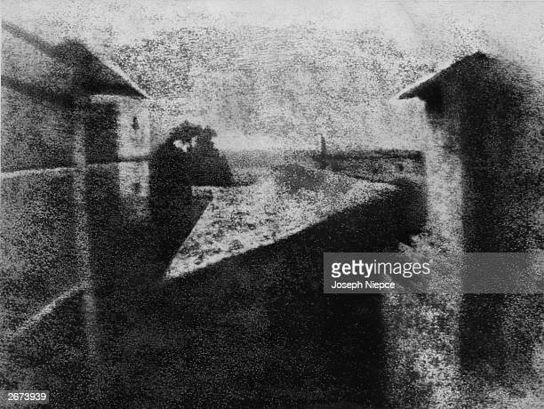 The world's first photograph by Joseph Niepce Taken from a window of his Le Gras estate at SaintLoupdeVarennes France it was produced by exposing a...