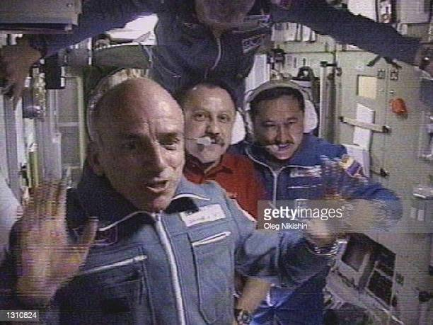 The worlds first space tourist Dennis Tito waves in front of the International Space Station crew shortly after his arrival to the station April 30...