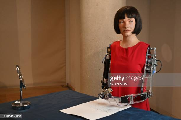 The worlds first ultra-realistic AI robot artist, Ai-Da, who can draw, paint and is a performance artist, is pictured during a press preview of the...