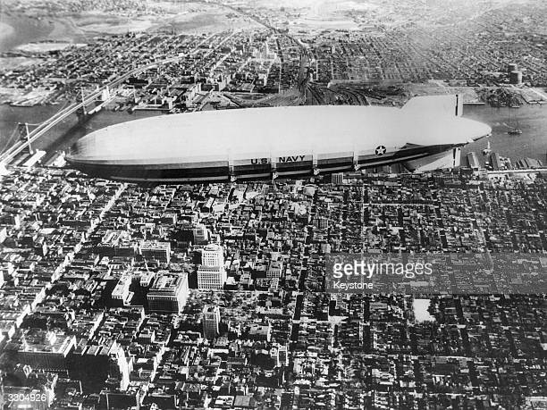 The world's largest airship the Akron, used by the US Navy, flying over Philadelphia.