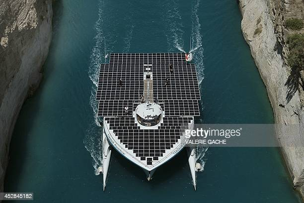 The world's largest solarpowered boat 'MS Turanor PlanetSolar' sails through the Corinth Canal near the town of Corinth on July 28 2014 The boat...