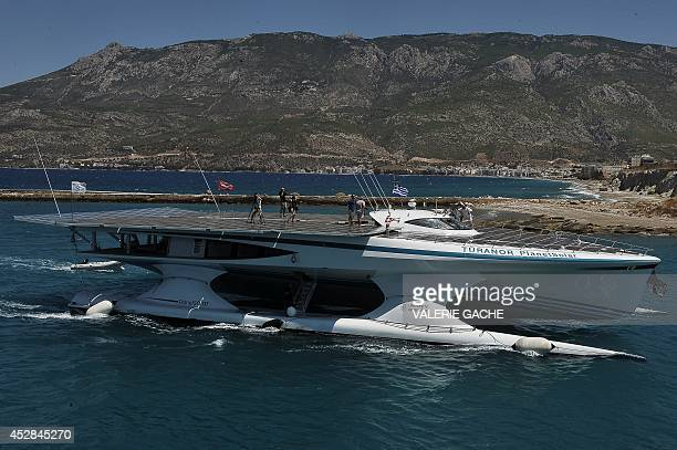 The world's largest solarpowered boat MS Turanor PlanetSolar sails through the Corinth Canal near the town of Corinth on July 28 2014 The boat...