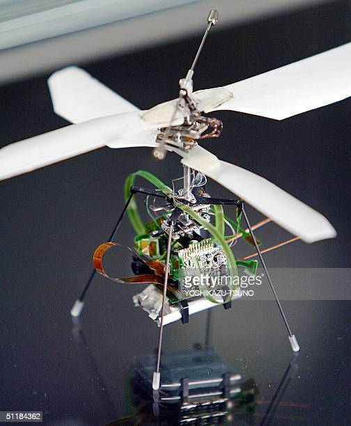 The world's lightest helicopter Micro Flying Robot II 85mm in eight 136mm in diameter of rotors weighing only 86g and produced by Japanese electronis...