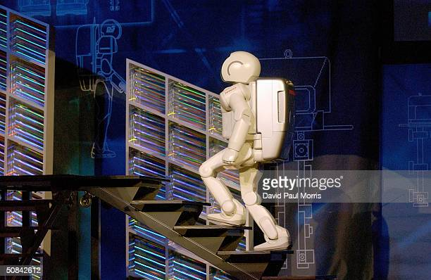 ASIMO the worlds most advanced humanoid robot goes through a demonstration at the WIRED NextFest at the Fort Mason Center May 15 2004 in San...
