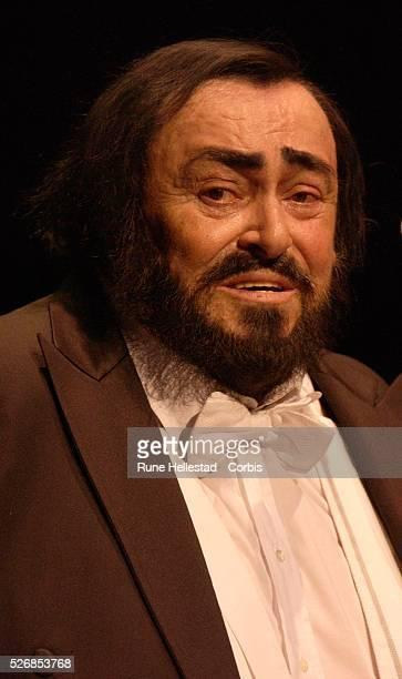 The world's most popular tenor Luciano Pavarotti appears on stage at the Royal Albert Hall Accompanied by the Royal Philharmonic Orchestra and...