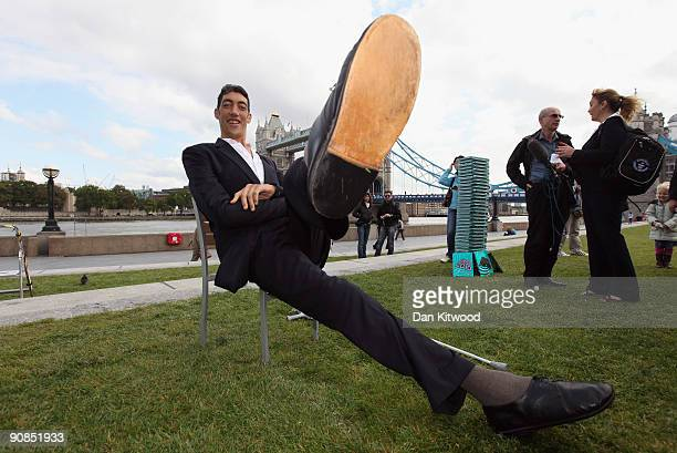The worlds new tallest man Sultan Kosen 26, of Turkey poses in front of Tower Bridge to celebrate the launch of the 2010 Guinness Book of Records, on...