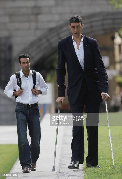 The worlds new tallest man Sultan Kosen 26 of Turkey poses with his brother Hasan Kosen in front of Tower Bridge to celebrate the launch of the 2010...