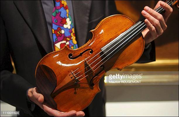 The world's oldest violin at the Antonio Stradivari museum held by one of the museum's music teachers Called 'Charles IX' it was signed by Andrea...