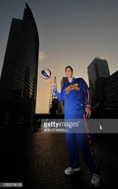 The world's tallest Basketball player, British man Paul 'Tiny' Sturgess, measuring 231.8cm high poses at Guinness World Records Day in London on...