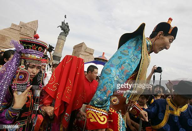 The world's tallest man Bao Xishun and his bride Xia Shujuan attend their traditional Mongolian wedding ceremony at Genghis Khan's Mausoleum on July...