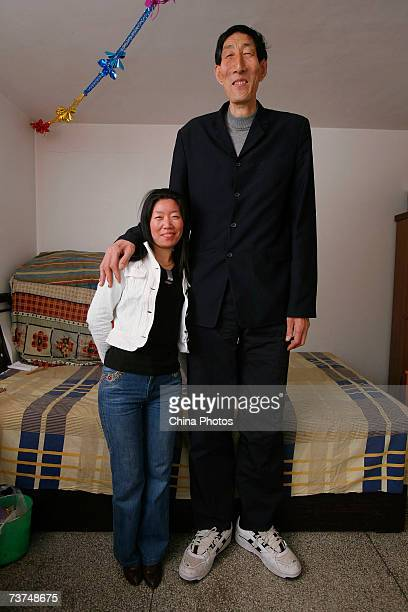 The world's tallest man Bao Xishun poses for a photo with his bride Xia Shujuan at home on March 30 2007 in Chifeng of Inner Mongolia Autonomous...
