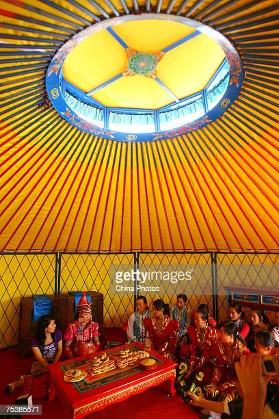 The world's tallest man Bao Xishun's bride Xia Shujuan attends their traditional Mongolian wedding ceremony in a yurt at Genghis Khan's Mausoleum on...