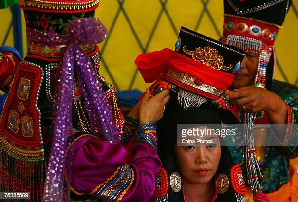 The world's tallest man Bao Xishun's bride Xia Shujuan gets ready during their traditional Mongolian wedding ceremony at Genghis Khan's Mausoleum on...