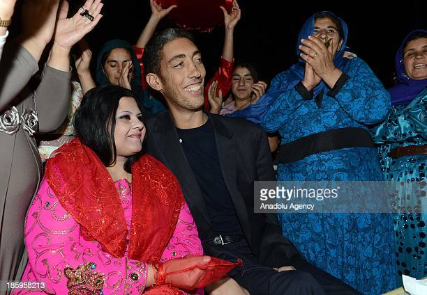 The World's tallest man Sultan Kosen and his fiancee Merve Dibo during their henna night the ceremony held one day before the wedding on October 26...