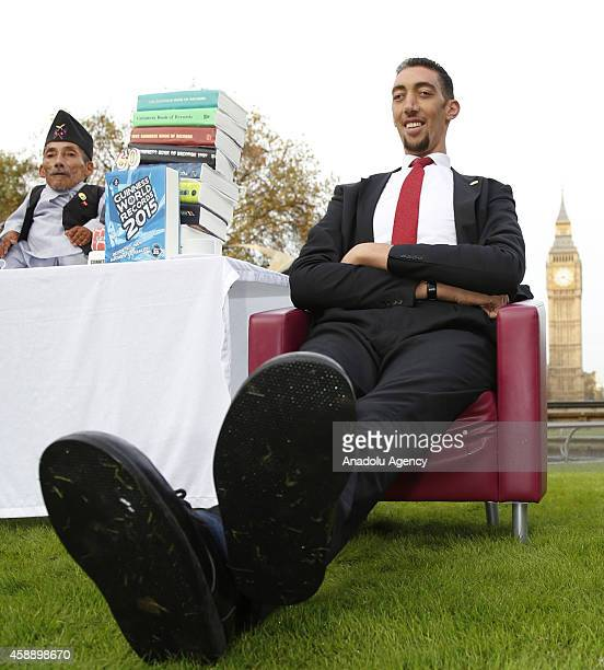 The worlds tallest man Sultan Kosen meets with the shortest man ever Chandra Bahadur Dangi for the very first time on November 13 2014 in London...