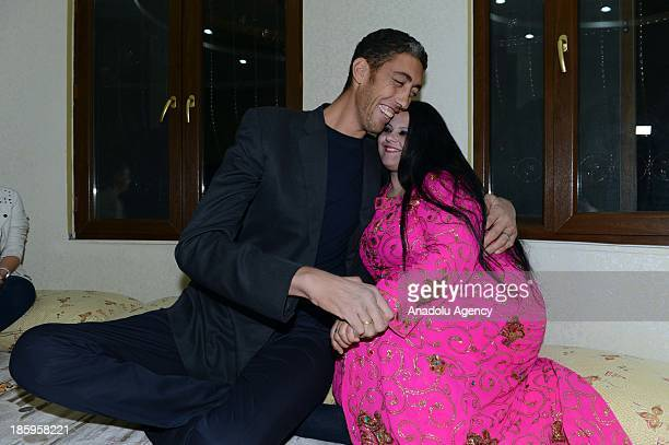 The World's tallest man Sultan Kosen poses with his fiancee Merve Dibo during their henna night the ceremony held one day before the wedding on...