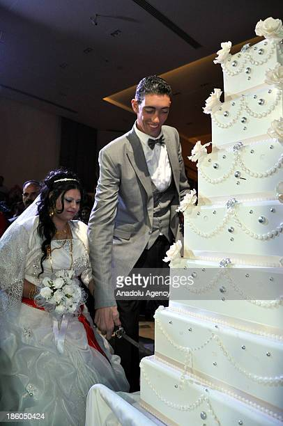 The World's tallest man Sultan Kosen whose height is measured at 2 meters 51 centimeters and Merve Dibo cut their wedding cake during their wedding...